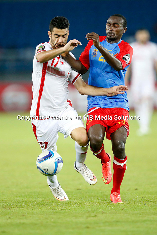 Hamza Mathlouthi of Tunisia vies against Frimin Mubele Ndombe of Democratic Republic of Congo during their AFCON match at the Estadio de Bata on January 26, 2014.The match ended 1-1.Photo/Mohammed Amin/www.pic-centre.com (Equatorial Guinea)