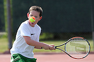 Parker Sprague of Cedar Rapids eyes the ball during a Boys' 10 Singles match at the 2011 Baird Iowa Open tennis tournament at Westfield Tennis Club in Cedar Rapids on Wednesday, July 27, 2011. Over 200 players from Colorado, Illinois, Iowa, and South Dakota, participated in the event.