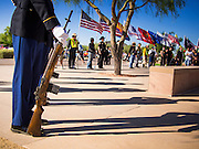 08 OCTOBER 2013 - PHOENIX, AZ: Veterans hold flags at a service honoring unclaimed military veterans in Phoenix. The cremated remains of 36 unclaimed US military veterans were interred at the National Memorial Cemetery in Phoenix. Members of the US military and several hundred veterans of the US military attended the service, which was a part of the Missing In America Project (MIAP).      PHOTO BY JACK KURTZ