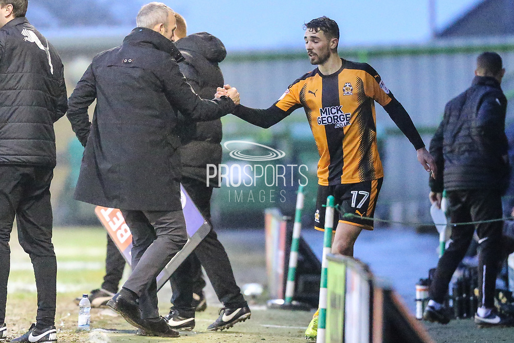Cambridge United's Adam Phillpis(17) is subbed and shakes hands with Cambridge United's manager Shaun Derry during the EFL Sky Bet League 2 match between Forest Green Rovers and Cambridge United at the New Lawn, Forest Green, United Kingdom on 20 January 2018. Photo by Shane Healey.
