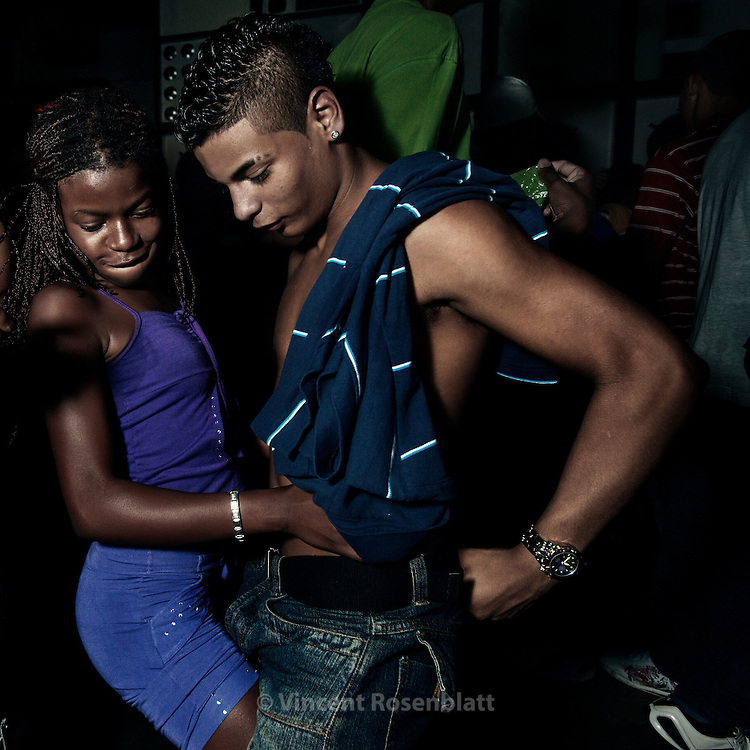 A moment of seduction.  Baile Funk on sunday night at Club 18, in the borough of Olaria, by the entry of the Complexo do Alemão favelas.