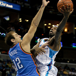 Oct 10, 2009; New Orleans, LA, USA; New Orleans Hornets forward Julian Wright (32) shoots over Oklahoma City Thunder center Nenad Krstic (12) during the first quarter at the New Orleans Arena. Mandatory Credit: Derick E. Hingle-US PRESSWIRE