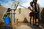Children fill a bucket with water from a hand pump in the village of Ambidedi Poste, Mali on Friday September 3, 2010.