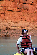 John Walcott looks up to the top of the Redwall as the Colorado River cuts through the canyon.  The redwall usually rises 500 feet up from the river.