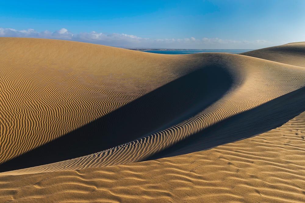Desert sand dunes at the Lagoon of Khenifiss (Lac Naila).