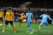 Mark Byrne  of Newport county &copy; hits a long range shot wide of the goal.  Skybet football league two match, Newport County v Cambridge Utd at Rodney Parade ,Newport , South Wales on Monday 8th  Sept 2014<br /> pic by Andrew Orchard, Andrew Orchard sports photography.