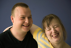 Portrait of day service users with learning disabilities laughing,