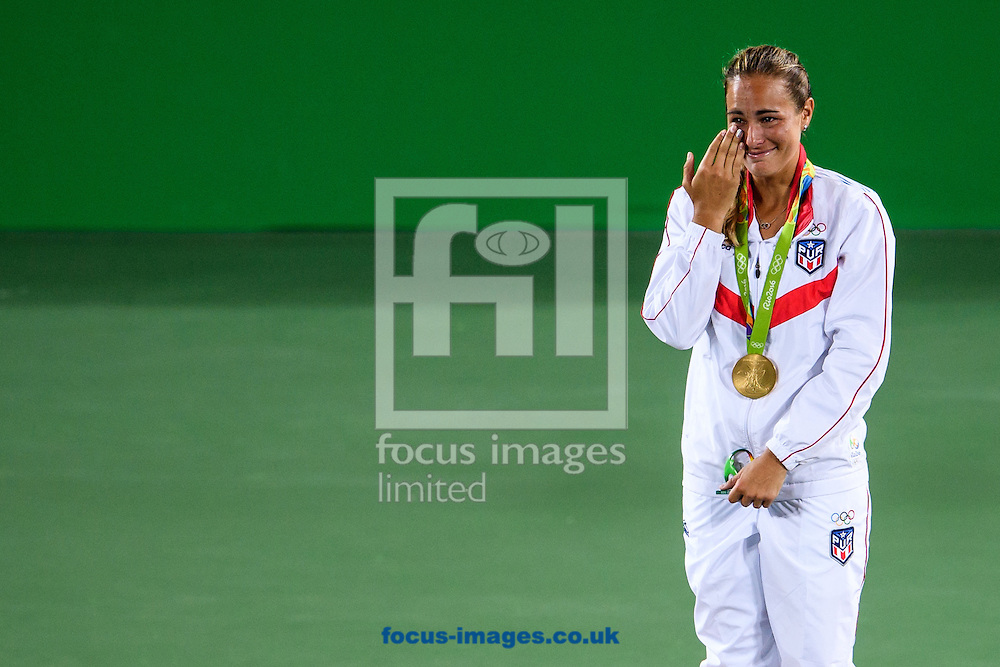 Monica Puig of Puerto Rico wins the Gold Medal in the Women's Tennis Singles on day eight of the XXXI 2016 Olympic Summer Games in Rio de Janeiro, Brazil.<br /> Picture by EXPA Pictures/Focus Images Ltd 07814482222<br /> 13/08/2016<br /> *** UK &amp; IRELAND ONLY ***<br /> <br /> EXPA-EIB-160814-0024.jpg