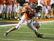 Prairie's Jesse Vizzini (6) is pulled down by Kennedy's Kyle Brewer (33) after a catch during their game at John Wall Memorial Stadium at Prairie High School in Cedar Rapids on Friday, September 6, 2013.