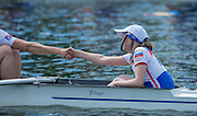 Hazewinkel, Belgium.  RUS JM8+, Cox, Anastasia BAZHENOVA, shakes hands with the stroke before the start of the heat. 2014 European Junior Championships, Bloso, Rowing Course, Heindonk, Willebroek, near Mechelen, <br /> 12:05:42  Saturday  24/05/2014<br /> [Mandatory Credit: Peter Spurrier/Intersport<br /> Images]
