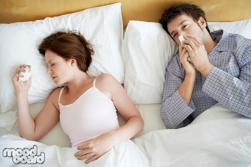Couple with Colds Lying in Bed high angle view