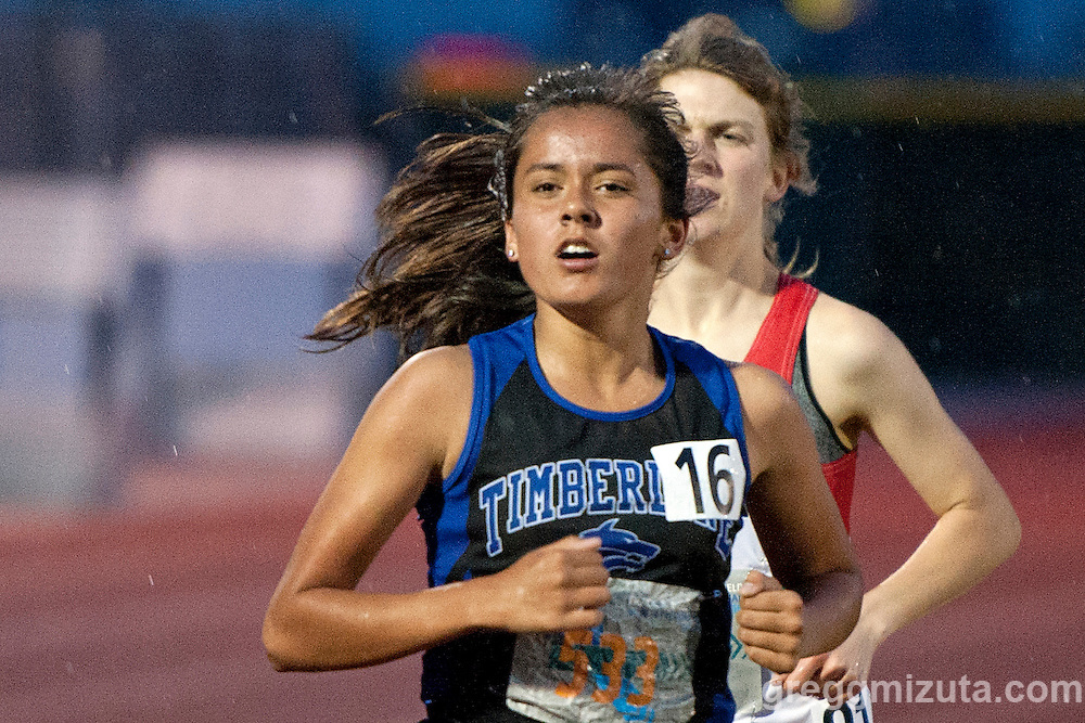 Timberline sophomore Presley Roldan and Boise senior Audrey Rustad race in a rainy 1600 during the YMCA Track &amp; Field Invitational on April 22, 2016 at Mountain View High School, Meridian, Idaho.<br /> <br /> Rustad finished fourth in 5:22.01 and Roldan finished fifth with a time of 5:23.26.