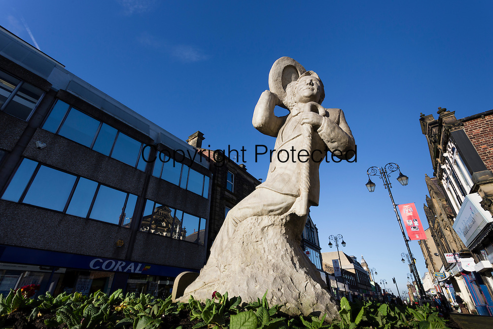 Statue of Ernie Wise in Morley town centre. The statue is close to the site of a theatre in which Wise performed as a boy. The statue cost £8,000 and was funded by Wise's widow Doreen Wiseman. It was unveiled in 2010.
