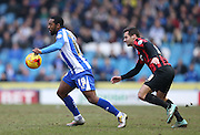 Jacques Maghoma, Sheffield Wednesday midfielder gets away from Sam Baldock, Brighton striker during the Sky Bet Championship match between Sheffield Wednesday and Brighton and Hove Albion at Hillsborough, Sheffield, England on 14 February 2015.