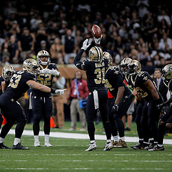 Nov 5, 2017; New Orleans, LA, USA; New Orleans Saints safety Chris Banjo (31) celebrates with teammates by mocking a free throw after a turnover against the Tampa Bay Buccaneers during the second half of a game at the Mercedes-Benz Superdome. The Saints defeated the Buccaneers 30-10. Mandatory Credit: Derick E. Hingle-USA TODAY Sports