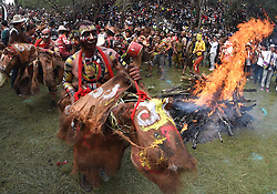 Men of Yi ethnic group ride dummy horses beside a bonfire during the annual fire worshipping festival, which falls on the third day of the second month in the Chinese lunar calendar at Xiyi Township under Mile City, southwest China's Yunnan Province, March 11, 2016. EXPA Pictures © 2016, PhotoCredit: EXPA/ Photoshot/ Lin Yiguang<br /> <br /> *****ATTENTION - for AUT, SLO, CRO, SRB, BIH, MAZ, SUI only*****