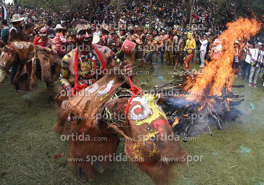 Men of Yi ethnic group ride dummy horses beside a bonfire during the annual fire worshipping festival, which falls on the third day of the second month in the Chinese lunar calendar at Xiyi Township under Mile City, southwest China's Yunnan Province, March 11, 2016. EXPA Pictures &copy; 2016, PhotoCredit: EXPA/ Photoshot/ Lin Yiguang<br /> <br /> *****ATTENTION - for AUT, SLO, CRO, SRB, BIH, MAZ, SUI only*****
