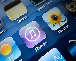 Close-up of screen of iPhone 4G smart phone showing itunes music app