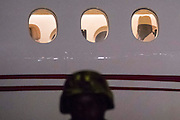 BANJUL, GAMBIA - JAN 20: Gambia's former dictator Yaya Jammeh is pictured through the window of a private jet as he prepares to live The Gambia after stepping down and reaching an uncertain agreement with ECOWAS forces on 21 January 2017 in Banjul, Gambia.