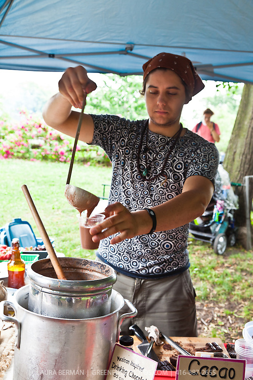 ChocoSol's Ilyan Balicki pours drinking chocolate at Dufferin Grove farmers market.