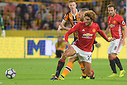 Manchester United player Marouane Fellaini (27) fights for ball with Hull City midfielder David Meyler (7) during the Premier League match between Hull City and Manchester United at the KCOM Stadium, Kingston upon Hull, England on 27 August 2016. Photo by Ian Lyall.