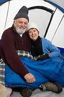 Senior couple sitting in tent, portrait