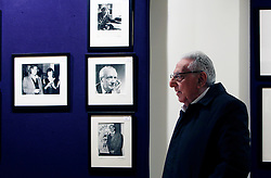 © Licensed to London News Pictures 08/04/2013.Photographer Mark Gerson, 91, stands infront of some of his photographs (including an image of Ted Hughes with his sister (photo far left)), which will sold as part of the 'Roy Davids Collection Part III: Poetry: Poetical Manuscripts and Portraits of Poets', on 10th April and 8th May, at Bonhams, London. .London, UK.Photo credit: Anna Branthwaite