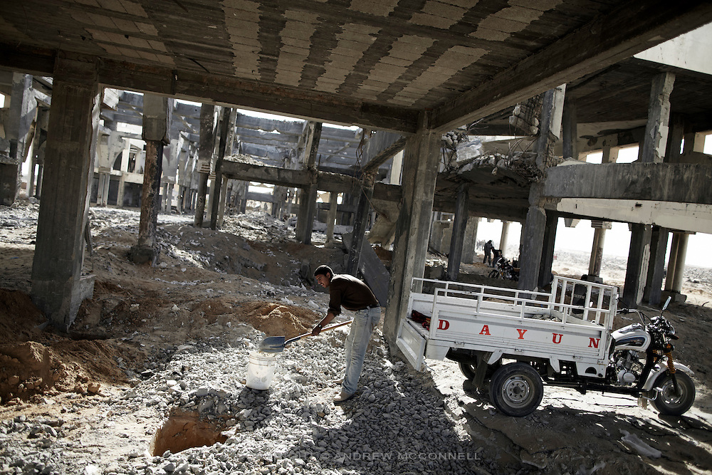 A man collects rubble from the main terminal at Yasser Arafat International Airport in southern Gaza. Aggregate like this is in short supply in Gaza, forcing scavengers to the border areas in search of rubble.