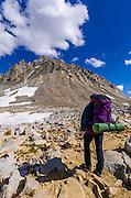 Backpacker on the Bishop Pass Trail under Mount Agassiz, John Muir Wilderness, Sierra Nevada Mountains, California USA