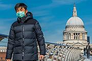 Masked on the Millennium Bridge - Anti Coronavirus (Covid 19) outbreak in London.