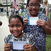 Young supporters show their tickets to the Barack Obama Grassroots event at the Kissimmee Civic Center in Kissimmee, Florida on Saturday, September 8, 2012. (AP Photo/Alex Menendez)