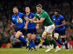 Jamie Heaslip of Ireland passes the ball - Mandatory byline: Patrick Khachfe/JMP - 07966 386802 - 11/10/2015 - RUGBY UNION - Millennium Stadium - Cardiff, Wales - France v Ireland - Rugby World Cup 2015 Pool D.