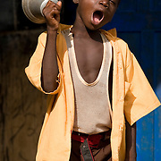 A boy rings a bell to announce the beginning of class at the Ying Anglican Primary School in the Savelugu-Nanton district, northern Ghana on Monday June 4, 2007. The school counts about 95 students aged three to 15..