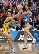 Donna Wilkins controls the ball despite the attention of Katrina Grant.<br /> ANZ Championship - Steel v Pulse, 28 May 2012, The Edgar Centre, Dunedin, New Zealand.<br /> Photo: Rob Jefferies / photosport.co.nz