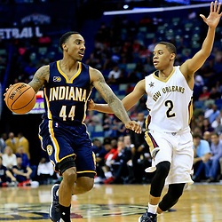 Oct 4, 2016; New Orleans, LA, USA;  Indiana Pacers guard Jeff Teague (44) drives past New Orleans Pelicans guard Tim Frazier (2) during the second quarter of a game at the Smoothie King Center. Mandatory Credit: Derick E. Hingle-USA TODAY Sports