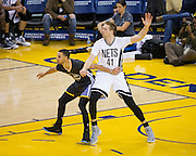 Golden State Warriors guard Stephen Curry (30) defends Brooklyn Nets center Justin Hamilton (41) at Oracle Arena in Oakland, Calif., on February 25, 2017. (Stan Olszewski/Special to S.F. Examiner)