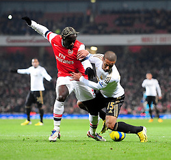 Arsenal's Bacary Sagna tackles Swansea City's Wayne Routledge - Photo mandatory by-line: Dougie Allward/JMP - Tel: Mobile: 07966 386802 16/01/2013 - SPORT - FOOTBALL - Emirates Stadium - London  -  Arsenal V Swansea City - FA Cup Third-Round replay