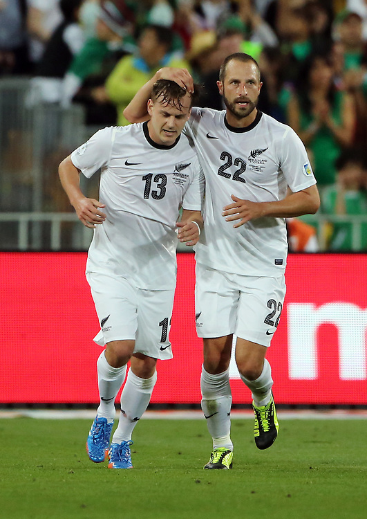 New Zealand's Chris James, left and Andrew Durante against Mexico in the World Cup Football qualifier, Westpac Stadium, Wellington, New Zealand, Wednesday, November 20, 2013. Cedit:SNPA / John Cowpland