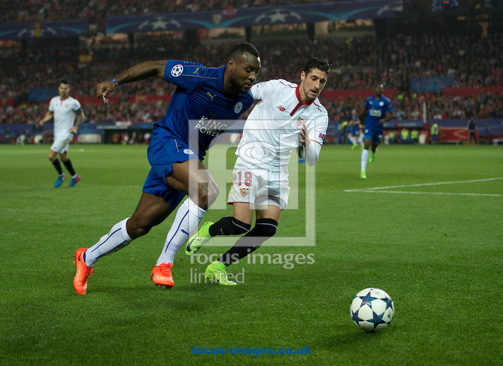 Wes Morgan of Leicester City (left) takes on Sergio Escudero of Sevilla during the UEFA Champions League match at Ramon Sanchez Pizjuan Stadium, Seville<br /> Picture by Russell Hart/Focus Images Ltd 07791 688 420<br /> 22/02/2017