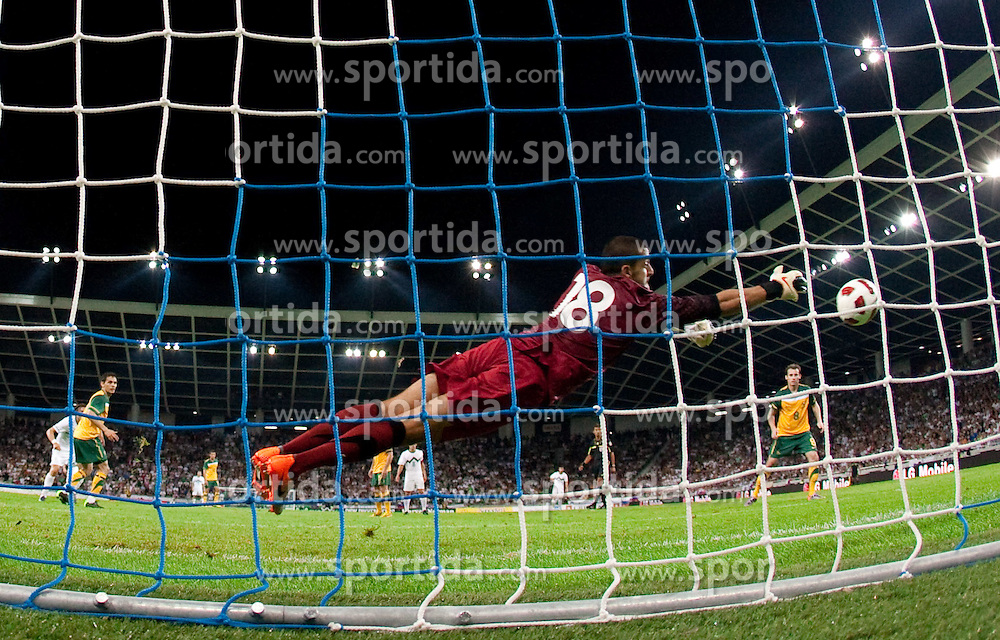 Zlatko Dedic of Slovenia scored vs Goalkeeper of Australia Adam Federici at opening ceremony and opening friendly football match of a new stadium in Stozice between National teams of Slovenia and Australia on August 11, 2010 in Ljubljana. Slovenia defeated Australia 2-0. (Photo by Vid Ponikvar / Sportida)