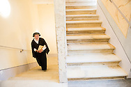 A period performer posing as Philipp Melanchthon climbs the new steps of The International Lutheran Center at the Old Latin School during the dedication on Sunday, May 3, 2015, in Wittenberg, Germany. LCMS Communications/Erik M. Lunsford
