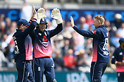 Joe Root of England celebrates taking the wicket of George Dockrell of Ireland who was trapped LBW with Eoin Morgan of England  and Sam Billings of England during the One Day International match between England and Ireland at the Brightside County Ground, Bristol, United Kingdom on 5 May 2017. Photo by Graham Hunt.