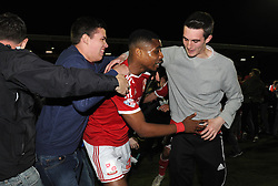 Swindon Town's Jonathan Obika is surrounded by fans during a pitch invasion  - Photo mandatory by-line: Dougie Allward/JMP - Mobile: 07966 386802 - 11/05/2015 - SPORT - Football - Swindon - County Ground - Swindon Town v Sheffield United - Sky Bet League One - Play-Off