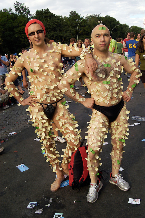 Two men don unique homemade costumes made of masking tape and thongs at Berlin's Love Parade.