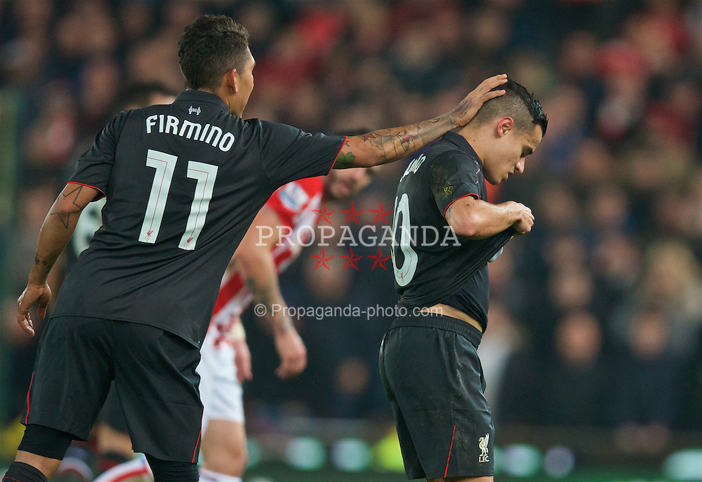 STOKE-ON-TRENT, ENGLAND - Tuesday, January 5, 2016: Liverpool's Philippe Coutinho Correia looks dejected as he walks off with a hamstring injury during the Football League Cup Semi-Final 1st Leg match against Stoke City at the Britannia Stadium. (Pic by David Rawcliffe/Propaganda)