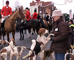 .TTP11-AP-BOXING DAY HUNT-DIG..PIC BY ANDREW PARSONS . BOXING DAY HUNT IN MALDON , ESSEX. THE ESSEX FARMERS HUNT STARTS IN MALDON HIGH ST . A HUNTING SURPORTER MAKING FRIENDS WITH ONE OF THE HOUNDS Boxing Day Hunt in Maldon, Essex. .The Essex farmers hunt starts in Maldon High St. 2000 .Photo by Andrew Parsons/i-Images....