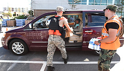 Volunteers load a vehicle with free supplies Tuesday, September 18, 2018 in downtown Wilmington, N.C. as New Hanover County, in partnership with FEMA, the Civil Air Patrol and volunteers from General Electric, gave out free water, tarps and the Meals Ready to Eat to county residents at three different locations in Wilmington. Photo by Chuck Liddy/Raleigh News & Observer/TNS/ABACAPRESS.COM