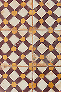 Maroon and yellow tile pattern
