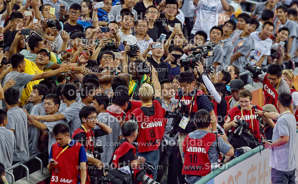 27-08-2015 CHN: IAAF World Championships Athletics day 6, Beijing<br /> Usain Bolt (JAM) with fans taking pictures with mobile phones