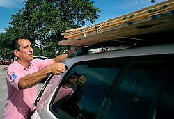September 4, 2017 - St Petersburg, Florida, U.S. - CARLOS ARGUELLO of St. Petersburg ties $200 worth of plywood on his car at the Home Depot on Monday. Hurricane Irma was upgraded to a Category 4 Hurricane. The storm could potentially hit Florida by next weekend. (Credit Image: © Cherie Diez/Tampa Bay Times via ZUMA Wire)